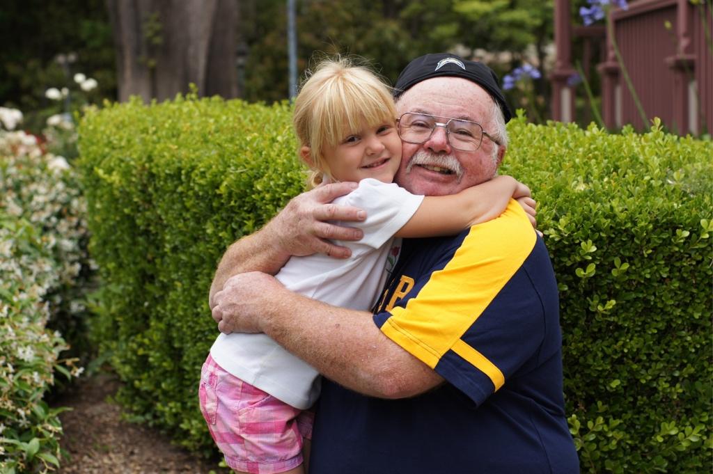 Grandad and child hugging
